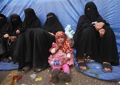 A girl sits among women during an anti-government rally to demand the ouster of Yemen's President Ali Abdullah Saleh at Tagheer square in Sanaa July 9, 2011. REUTERS/Suhaib Salem