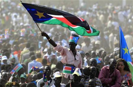 A man waves South Sudan's national flag as he attends the Independence Day celebrations in the capital Juba, July 9, 2011. REUTERS/Thomas Mukoya