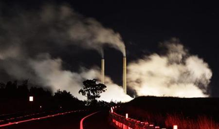 Steam and other emissions rise from a coal-fired power station near Lithgow, 120 km (75 miles) west of Sydney, July 7, 2011. Australia is set to slap a carbon tax of A$23 a metric ton ($24.60) on its major emitters, newspapers said on Thursday, but it has halved the number of companies liable for the tax in a bid to overcome hostility to the policy. REUTERS/Daniel Munoz