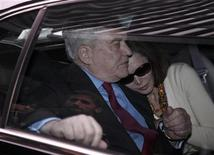 <p>Conrad Black and his wife Barbara Amiel leave federal court in Chicago, June 24, 2011. REUTERS/John Gress</p>