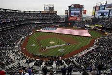 <p>A flag is stretched across the field for the national anthem before the start of the New York Mets home opener against the Washington Nationals National League game in MLB baseball action at Citi Field in New York April 8, 2011. REUTERS/Jessica Rinaldi</p>