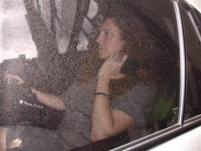 Rebekah Brooks is driven away from News Corp chairman Rupert Murdoch's flat in central London July 12, 2011. REUTERS/Andrew Winning