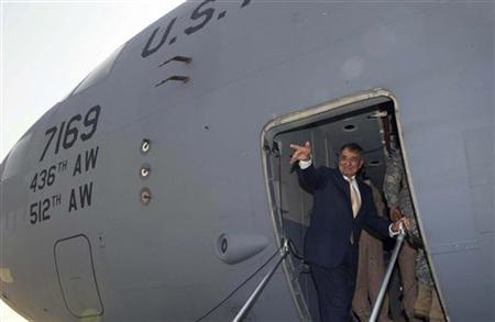 Secretary of Defense Leon Panetta waves as he leaves Baghdad, early July 12, 2011. REUTERS/Paul J. Richards/Pool