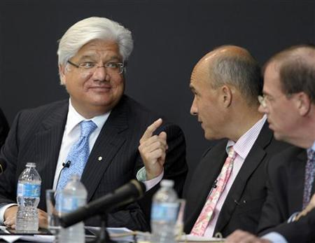 Research In Motion (RIM) Co-CEO Jim Balsillie (C) speaks with President and Co-CEO Mike Lazaridis (L) during the annual general meeting of shareholders in Waterloo July 12, 2011. REUTERS/ Mike Cassese