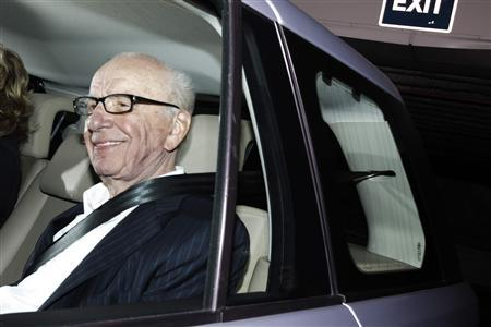 News Corp chairman Rupert Murdoch leaves the offices of News International in London July 13, 2011. REUTERS/Luke MacGregor