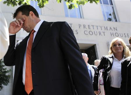 Former Major League Baseball pitcher Roger Clemens leaves the federal courthouse in Washington after the judge declared a mistrial, July 14, 2011. REUTERS/Yuri Gripas