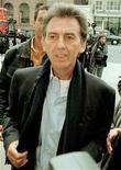 <p>Foto de archivo del fallecido cantautor George Harrison en Londres, mayo 6 1998. Un nuevo documental de George Harrison que exhibe filmaciones caseras, entrevistas y material nunca visto hará su debut en octubre en HBO, dijo el canal por cable. REUTERS/STR New</p>