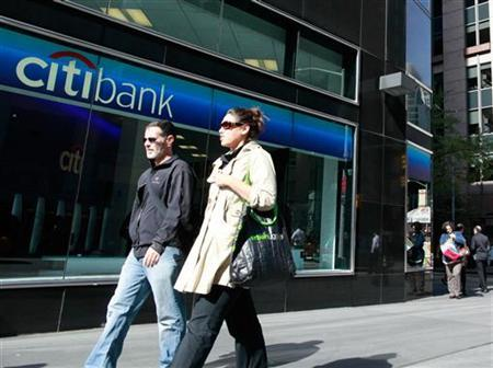 People walk past a Citibank branch in New York, October 18, 2010. REUTERS/Brendan McDermid
