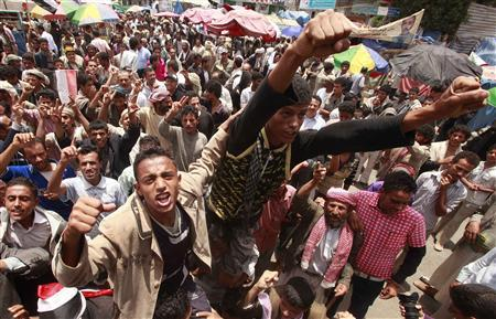 Anti-government protesters shout slogans during a rally to demand the ouster of Yemen's President Ali Abdullah Saleh at Tagheer square in Sanaa July 16, 2011. REUTERS/Suhaib Salem
