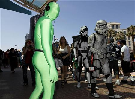 Attendees arrive dressed as ''Stormtroopers'' for the third day of the pop culture convention Comic Con in San Diego, California July 24, 2010. REUTERS/Mike Blake