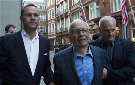 James and Rupert Murdoch (C) and a minder leave the Stafford Hotel in St James's Place, central London July 10, 2011. REUTERS/Olivia Harris