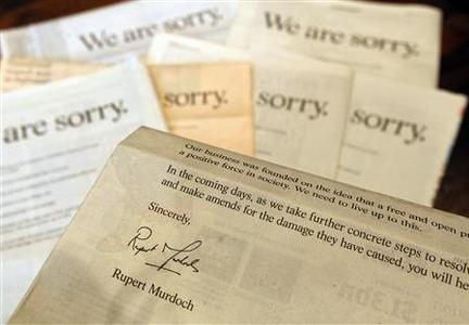 The Times, Sun, Guardian, Financial Times, Independent, Daily Mail, and Daily Telegraph newspapers are displayed featuring an apology from News Corp chairman and chief executive officer Rupert Murdoch, in London, July 16, 2011. REUTERS/Suzanne Plunkett
