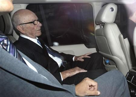 News Corp Chief Executive and Chairman Rupert Murdoch is driven from his home in London July 19, 2011. REUTERS/Suzanne Plunkett