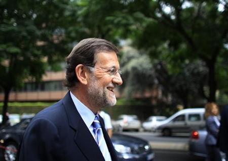Spain's main opposition Popular Party leader Mariano Rajoy attends a party meeting in the Andalusian capital in Seville July 1, 2011. REUTERS/Marcelo del Pozo