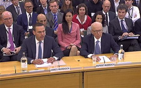 BSkyB Chairman James Murdoch, News Corp Chief Executive and Chairman Rupert Murdoch (R) appear before a parliamentary committee on phone hacking at Portcullis House in London July 19, 2011. REUTERS/Parbul TV via Reuters Tv