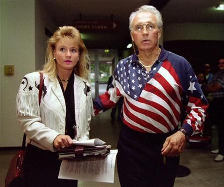 Former motorcycle daredevil Robert Craig ''Evel'' Knievel enters the Sunnyvale Municipal Court with his girlfriend Krystal Kennedy before pleading not guilty to weapons charges, October 25, 1994. REUTERS/Blake Sell