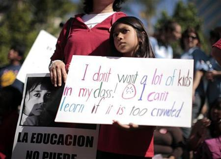 Jasmin Amezcua, 8, attends a protest against education budget cuts in Los Angeles, California May 13, 2011. REUTERS/Lucy Nicholson