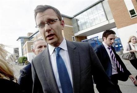 Andy Coulson, the former spokesman for Prime Minister David Cameron, leaves a police station after being bailed in South London, July 8, 2011. REUTERS/Olivia Harris