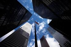 <p>Skyscrapers loom over a flagpole carrying the Canadian flag in the financial district in Toronto, March 11, 2009. REUTERS/Mark Blinch</p>