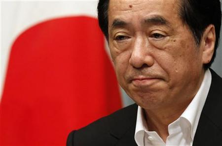 Japan's Prime Minister Naoto Kan attends a news conference at his official residence in Tokyo July 13, 2011. REUTERS/Kim Kyung-Hoon