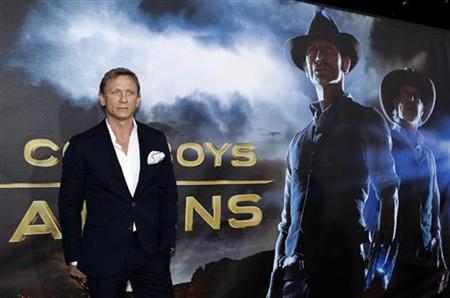 Actor Daniel Craig arrives for the world premiere of his new movie ''Cowboys & Aliens'' in conjunction with Comic Con in San Diego, California July 23, 2011. REUTERS/Mike Blake