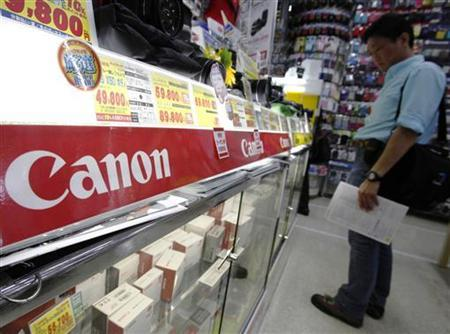Canon camera equipment is displayed at an electronic shop in Yokohama, south of Tokyo April 26, 2011. REUTERS/Yuriko Nakao