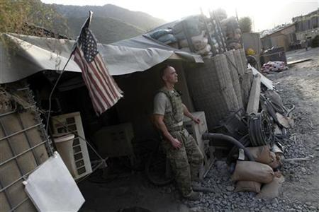 U.S. Army Staff Sergeant Eric Williams from 2 platoon, Alpha company, 2nd battalion, 27th Infantry Regiment stands at Combat Outpost Pirtle King in Kunar province, Afghanistan, July 18, 2011. REUTERS/Baz Ratner