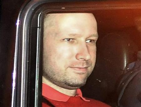 Norwegian Anders Behring Breivik, the man accused of a killing spree and bomb attack in Norway, sits in the rear of a vehicle as he is transported in a police convoy as he is leaving the courthouse in Oslo July 25, 2011. REUTERS/Jon-Are Berg-Jacobsen/Aftenposten via Scanpix