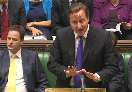 Prime Minister David Cameron, flanked by Deputy Prime Minister Nick Clegg (L), speaks about phone hacking to parliament in a still image taken from video in London, July 20, 2011. REUTERS/Parbul TV via Reuters TV