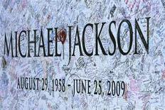 <p>A section of a large Michael Jackson poster is pictured outside Staples Center in Los Angeles July 6, 2009. REUTERS/Mario Anzuoni</p>