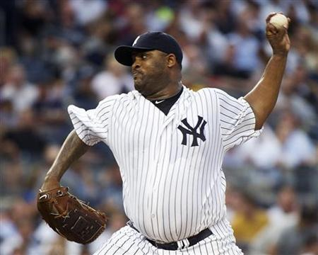 New York Yankees starting pitcher CC Sabathia throws a pitch to the Seattle Mariners in the third inning of their MLB American League baseball game at Yankee Stadium in New York, July 26, 2011. REUTERS/Ray Stubblebine
