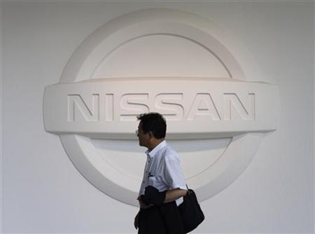 A man walks past a logo of Nissan Motor Co at the company showroom in Yokohama, south of Tokyo June 23, 2011. REUTERS/Toru Hanai