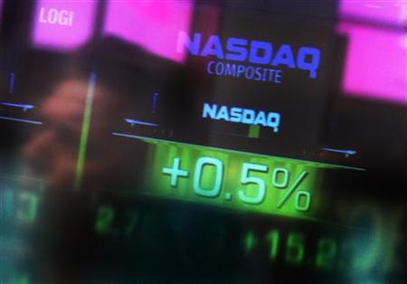 The Nasdaq Composite stock market index is seen inside their studios at Times Square in New York April 1, 2011. REUTERS/Shannon Stapleton