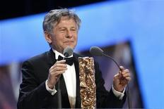 "<p>Director Roman Polanski reacts after winning the Best Director award for his film ""The Ghost Writer"" during the 36th Cesar Awards ceremony in Paris February 25, 2011. REUTERS/Benoit Tessier</p>"