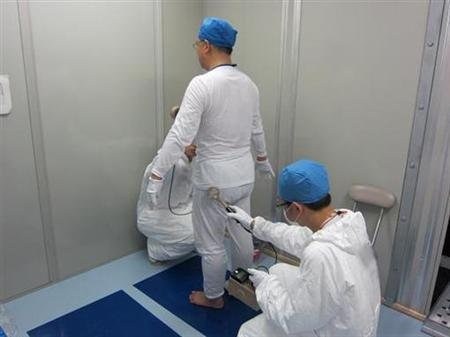 Workers conduct a radiation survey inside a rest area installed at the Fukushima Daiichi nuclear power plant in northern Japan, in an undated photo recently July 2, 2011. REUTERS/Tokyo Electric Power Co