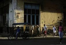 <p>A man looks for customers on his tricycle taxi in Havana July 28, 2011. REUTERS/Desmond Boylan</p>