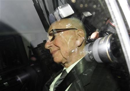 News Corp chairman Rupert Murdoch is driven from his apartment in London, July 18, 2011 REUTERS/Paul Hackett