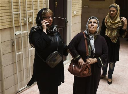 Ameneh Bahrami, who was blinded in both eyes in an acid attack, arrives at her home with her mother (C) in Tehran July 31, 2011. REUTERS/Raheb Homavandi
