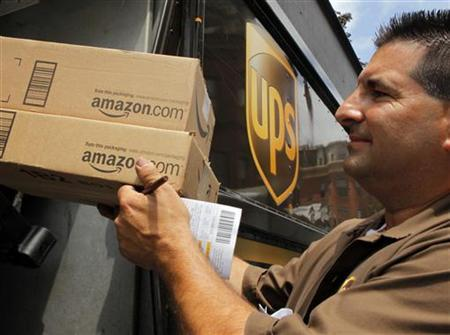 UPS driver T.J. Dellasala delivers two packages from Amazon.com in Boston, Massachusetts July 26, 2011. REUTERS/Brian Snyder