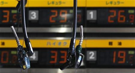 Pumps are seen at a gas station in Tokyo June 24, 2011. REUTERS/Kim Kyung-Hoon
