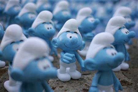 Smurfs figurines are displayed on a fountain during a photocall for the film ''The Smurfs'' in Cancun July 10, 2011. REUTERS/Victor Ruiz Garcia