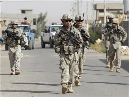 U.S. soldiers attached to the Golden Lions forces patrol a street in the city of Kirkuk, 250 km (155 miles) north of Baghdad July 20, 2011. REUTERS/Saad Shalash
