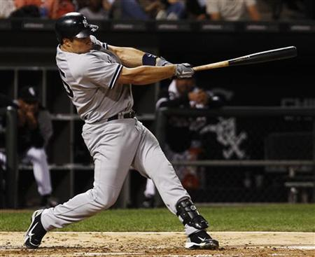 New York Yankees Mark Teixeira hits a home run against the Chicago White Sox during the third inning of their American League baseball game in Chicago, August 2, 2011. REUTERS/Jim Young