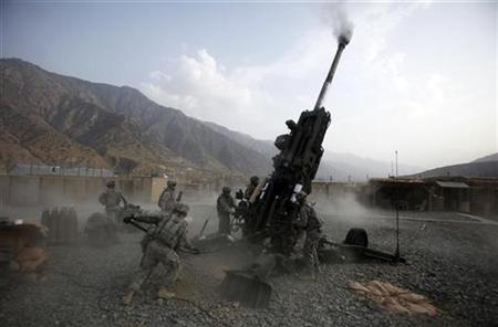 U.S. Army soldiers from 2nd Platoon, Charlie Battery, 3rd Regiment, 321st field artillery, 82nd Airborne Division reload a M777 howitzer at Forward Operating Base Bostick in Kunar province, Afghanistan, July 13, 2011. REUTERS/Baz Ratner