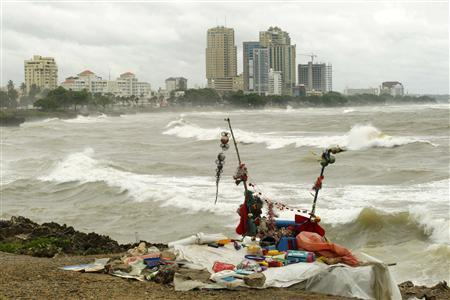 A homeless shelter is seen on the malecon as tropical storm Emily arrives to Santo Domingo August 3, 2011. REUTERS/Eduardo Munoz