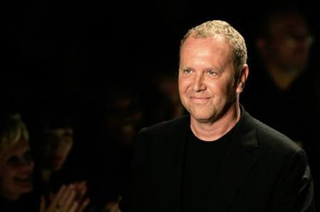 Designer Michael Kors smiles on the runway at the end of his Spring Collections 2007 show during New York fashion week September 13, 2006. REUTERS/Eduardo Munoz
