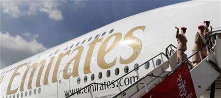 Emirates cabin crew board an Emirates Airbus A380-800 at Manchester Airport in Manchester, northern England, September 1, 2010. REUTERS/Phil Noble