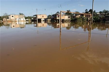 The goal posts at a flooded soccer field is seen after flood waters receded in the Ribeira do Iguape riverside suburb of Registro, 300km (186 miles) south of Sao Paulo August 5, 2011. REUTERS/Paulo Whitaker