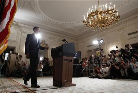 REFILE - CORRECTING SPELLING OF AFGHANISTAN U.S. President Barack Obama walks out to make a statement about the economy and U.S. servicemen recently killed in Afghanistan to the media in the State Dining Room of the White House in Washington, August 8, 2011. REUTERS/Larry Downing