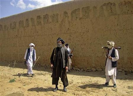 Taliban fighters pose with weapons at an undisclosed location in southern Afghanistan, May 5, 2011. REUTERS/Stringer